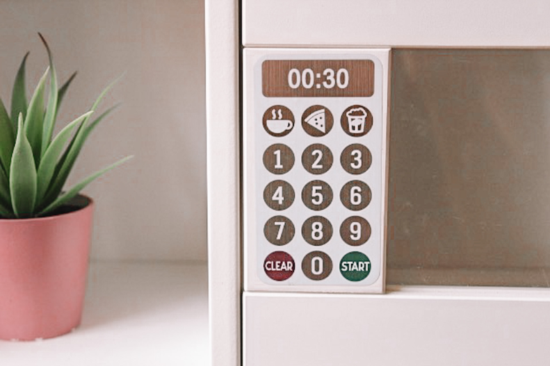 A picture containing indoor, microwave, cabinet, white  Description automatically generated